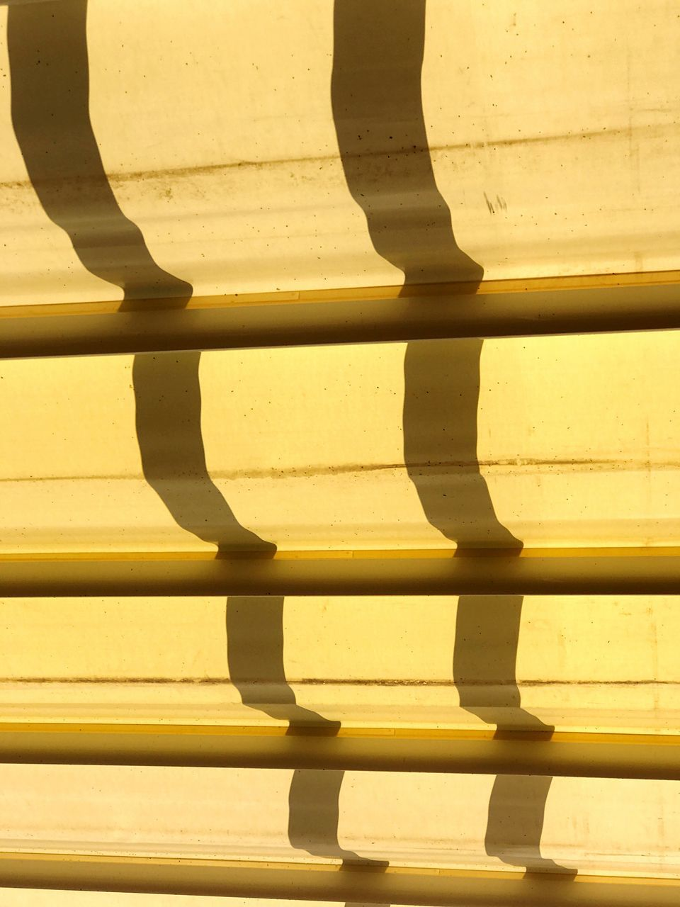 full frame, backgrounds, no people, close-up, yellow, shadow, sunlight, outdoors, day, architecture, line, chess piece