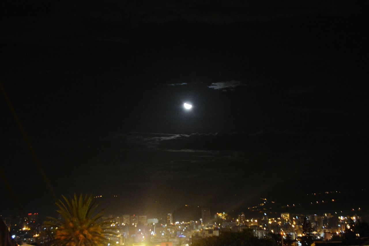 Illuminated Night City Quito Ecuador Firework Display Moon Event Celebration Sky Firework - Man Made Object Nightlife Outdoors No People Star - Space Cityscape Astronomy