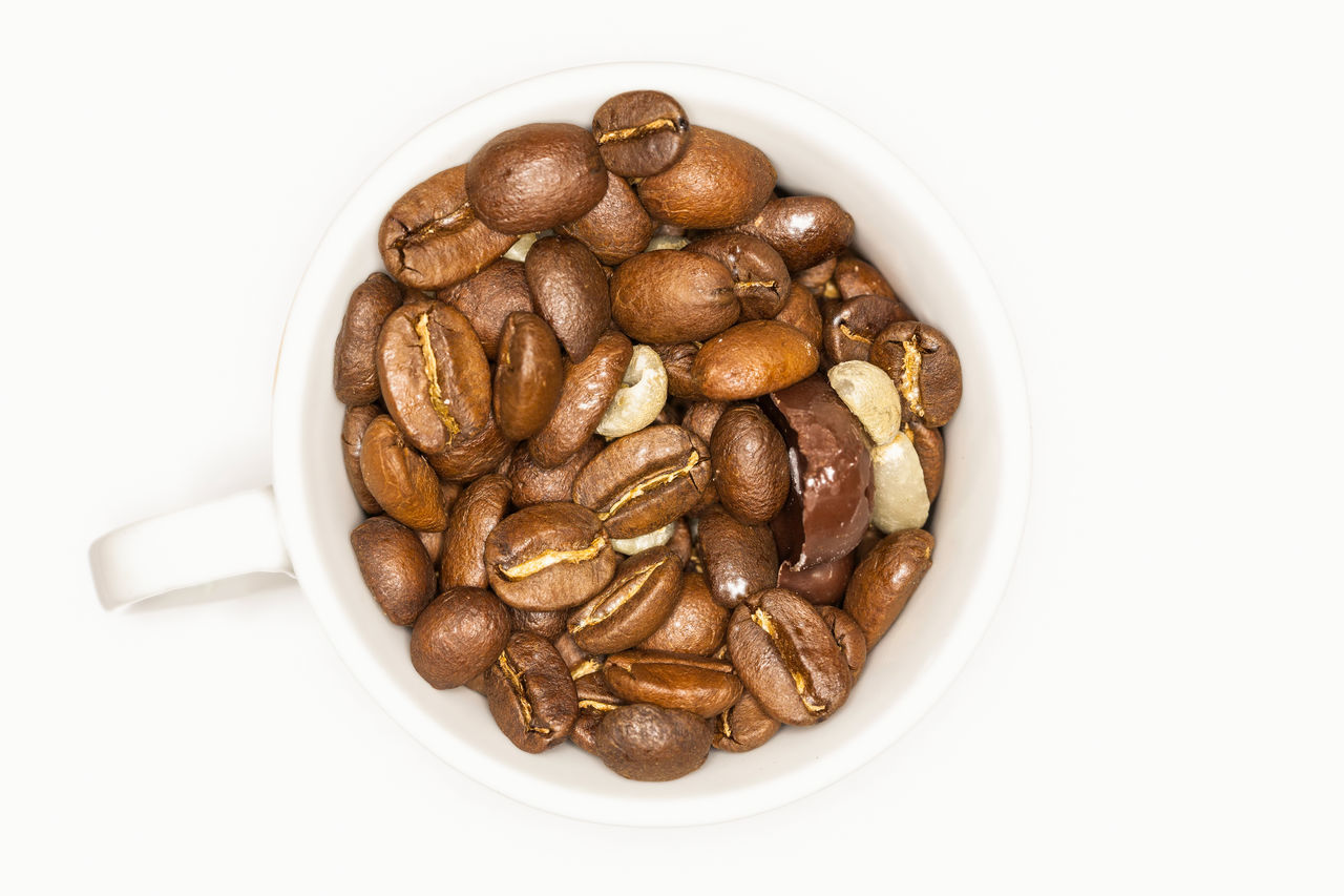 Close Up Of A White Coffee Cup Full Of Coffee Brown Beans On A White Background Beans Brown Brown Color Chocolate Close-up Coffee Coffee Shop Coffee Time Cup Directly Above Food Food And Drink Freshness Happy Healthy Eating High Angle View Love No People Seed Smell Studio Shot Vegan Vegetarian White White Background