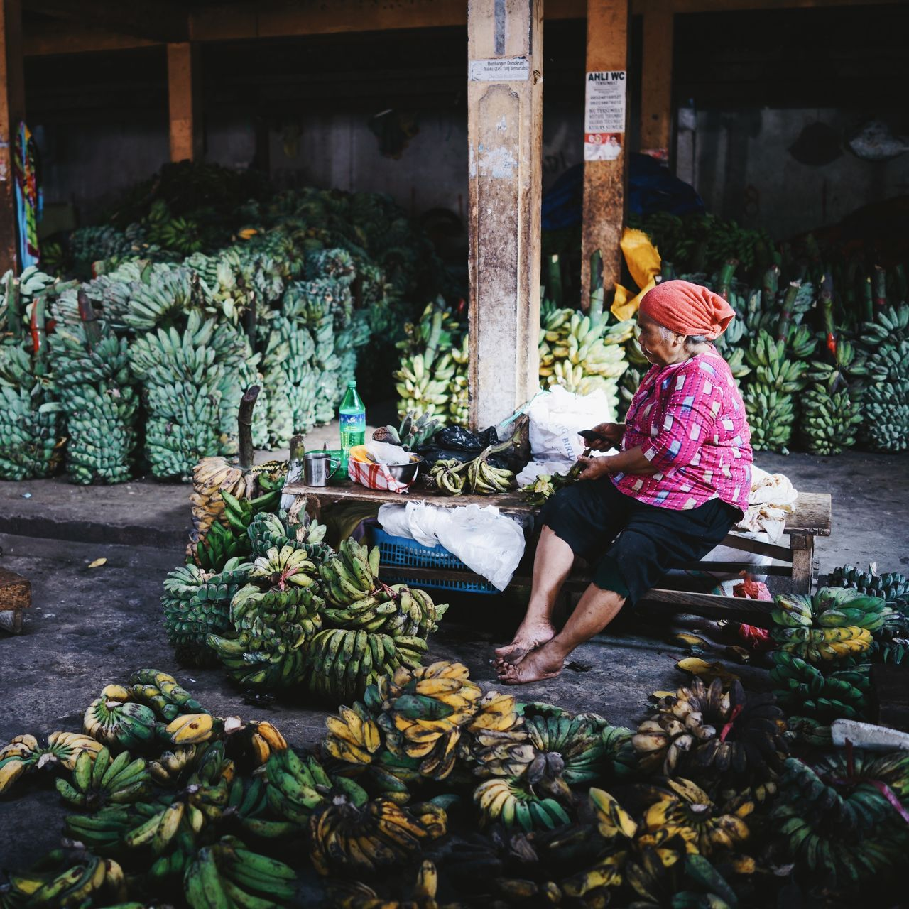 ASIA Bananas Day Fruits Green Bananas INDONESIA Indoors  Maluku  Market Old Woman Portrait Retail  Selling Selling Banana Sitting Ternate Traveling Woman Women Yellow Bananas The Portraitist - 2017 EyeEm Awards The Photojournalist - 2017 EyeEm Awards