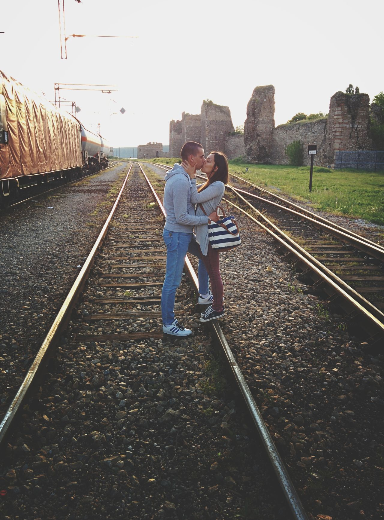 Two People Full Length Childhood Outdoors Togetherness Rear View Real People Men Day Friendship People Adult Sky Young Adult Human Body Part Goodbye Train Train Station Leave Separation Kiss Rails Railstation