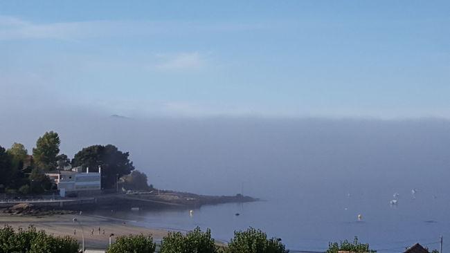Foggy Horizon Over Water
