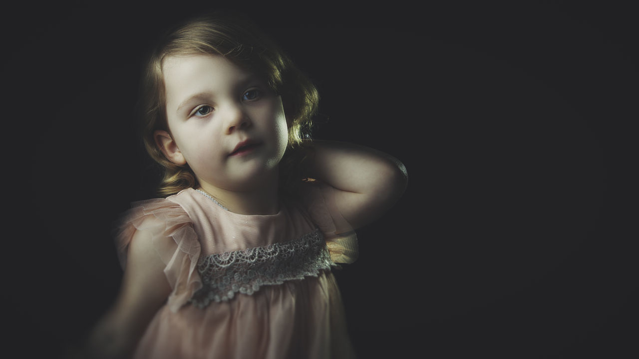 Girl Lost in Thought Beautiful People Beautiful Woman Beauty Black Background Blond Hair Child Childhood Children Only Close-up Daydream Daydreaming Front View Girl In Dress Girls Looking At Camera One Girl Only One Person People Portrait Studio Shot