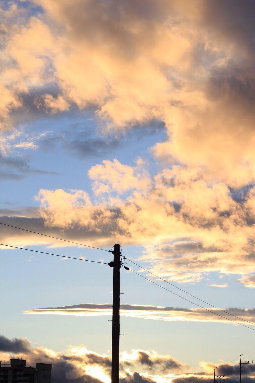 Electricity Pole Against Cloudy Sky