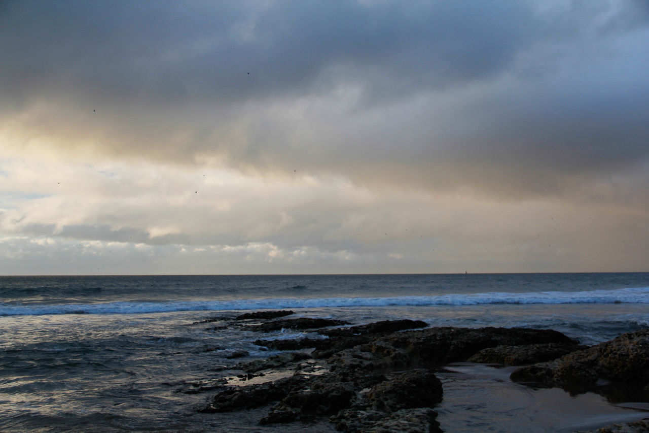 sea, horizon over water, nature, scenics, beauty in nature, water, sky, tranquility, tranquil scene, cloud - sky, beach, no people, outdoors, scenery, day