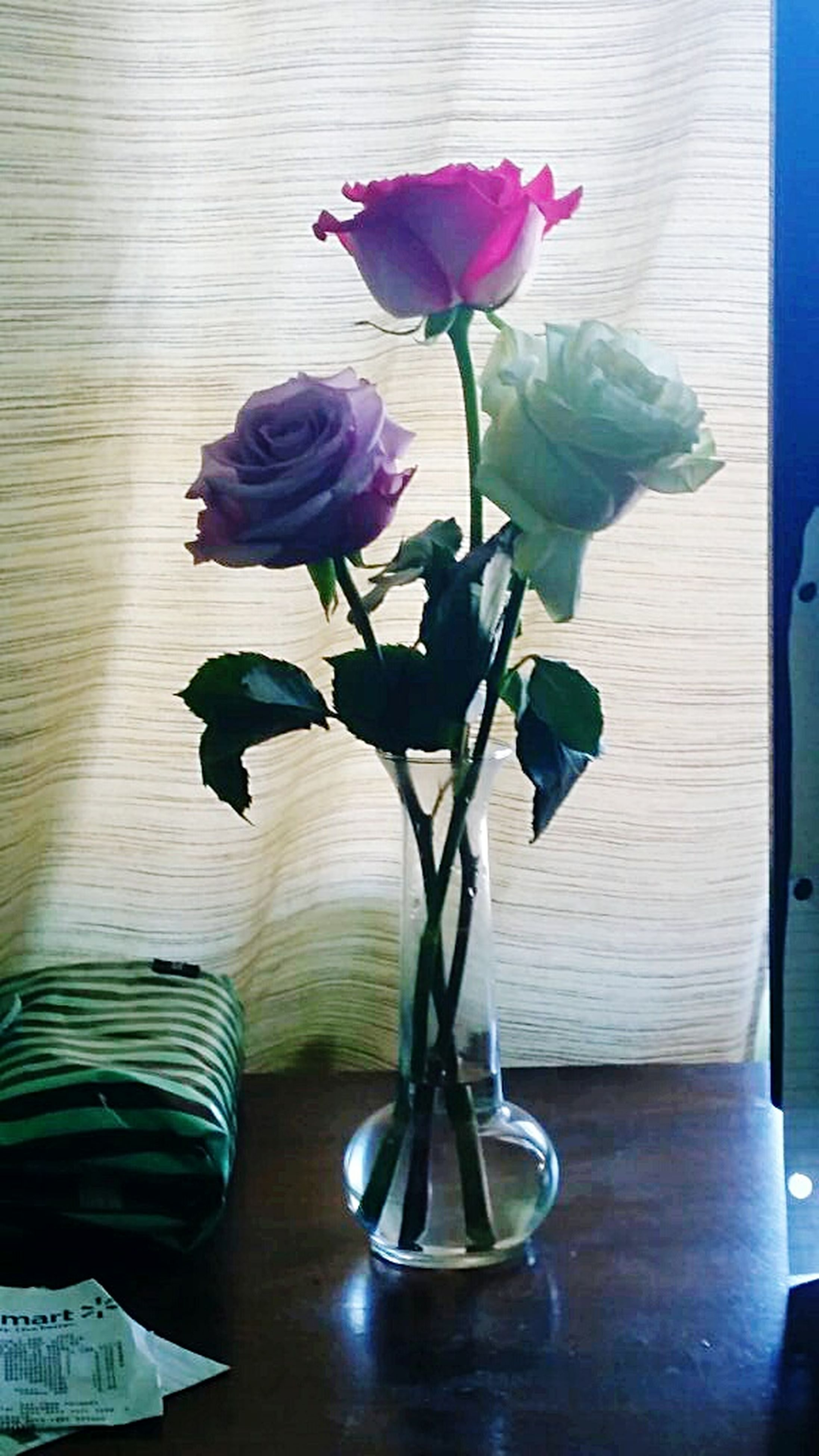 flower, indoors, vase, freshness, table, petal, fragility, leaf, flower head, stem, growth, plant, beauty in nature, potted plant, nature, flower arrangement, close-up, still life, rose - flower, home interior