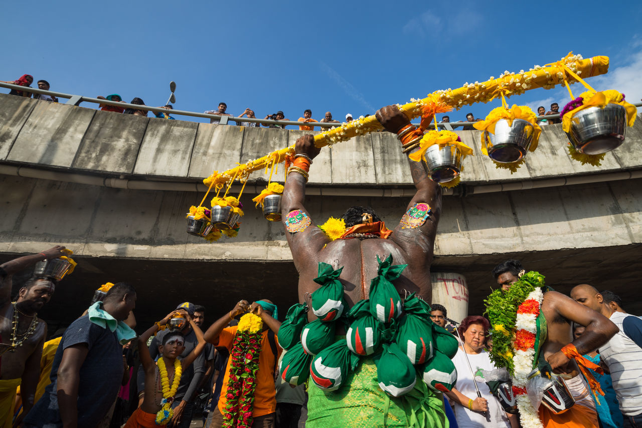 BATU CAVES, MALAYSIA - 9TH FEBRUARY 2017; Hindu devotees performing a pray session during Thaipusam festival in Batu Caves temple, celebrating Lord Murugan victory over the demon Soorapadman. Adult Adults Only Architecture Arts Culture And Entertainment Batu Caves -Malaysia Built Structure Celebration Ceremony Chinese New Year Cultures Day Event Headwear Hindu Culture Hinduism Large Group Of People Lifestyles Men New Year's Eve Outdoors People Thaipusam Tradition Traditional Clothing Women