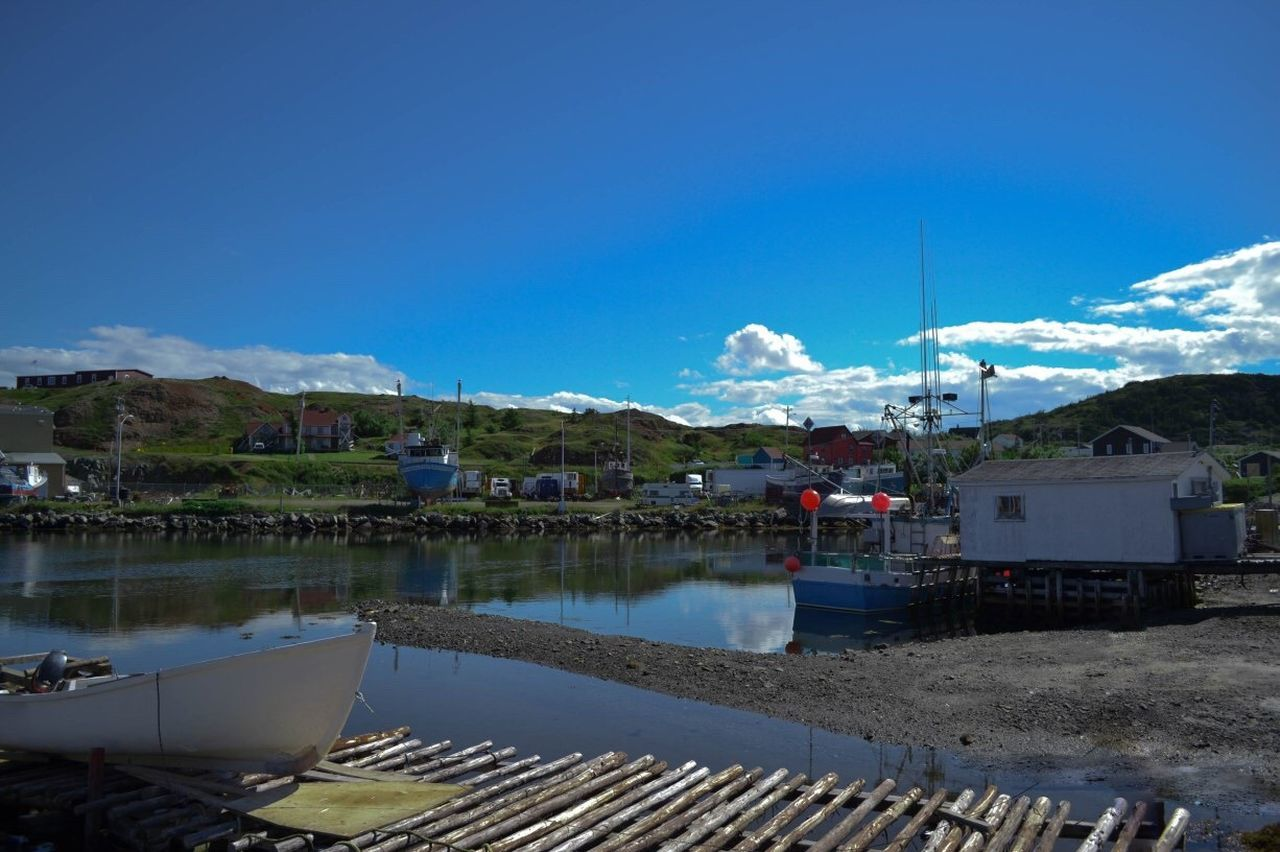 mountain, building exterior, water, built structure, outdoors, architecture, day, blue, sky, no people, nautical vessel, nature
