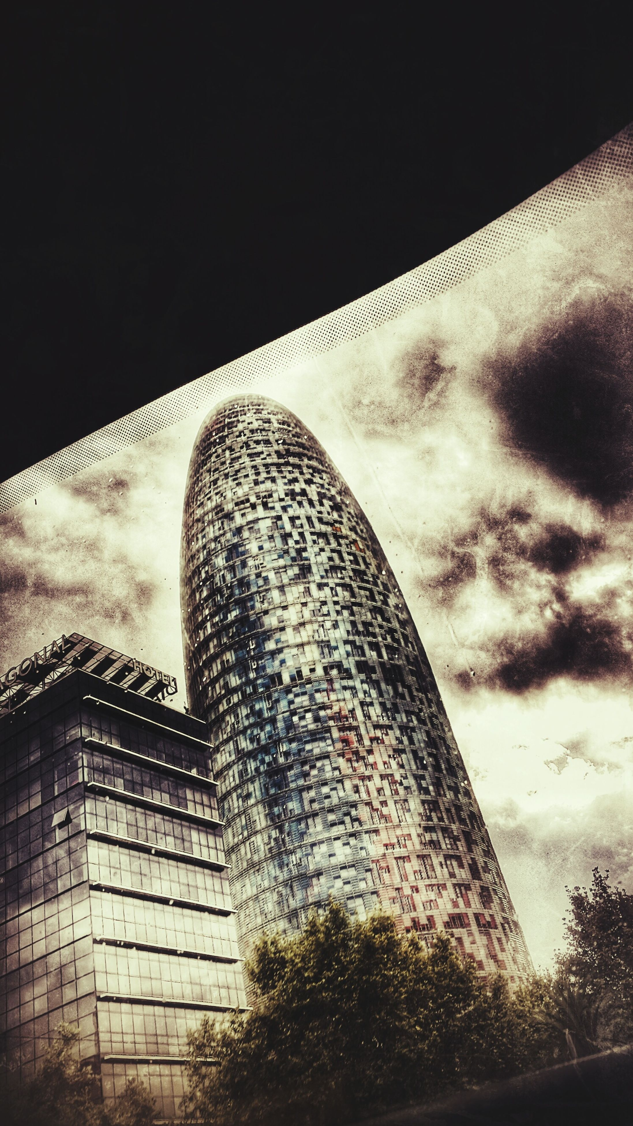 architecture, built structure, building exterior, low angle view, sky, modern, city, building, tall - high, office building, no people, outdoors, skyscraper, tower, glass - material, day, cloud - sky, window, reflection, sunlight
