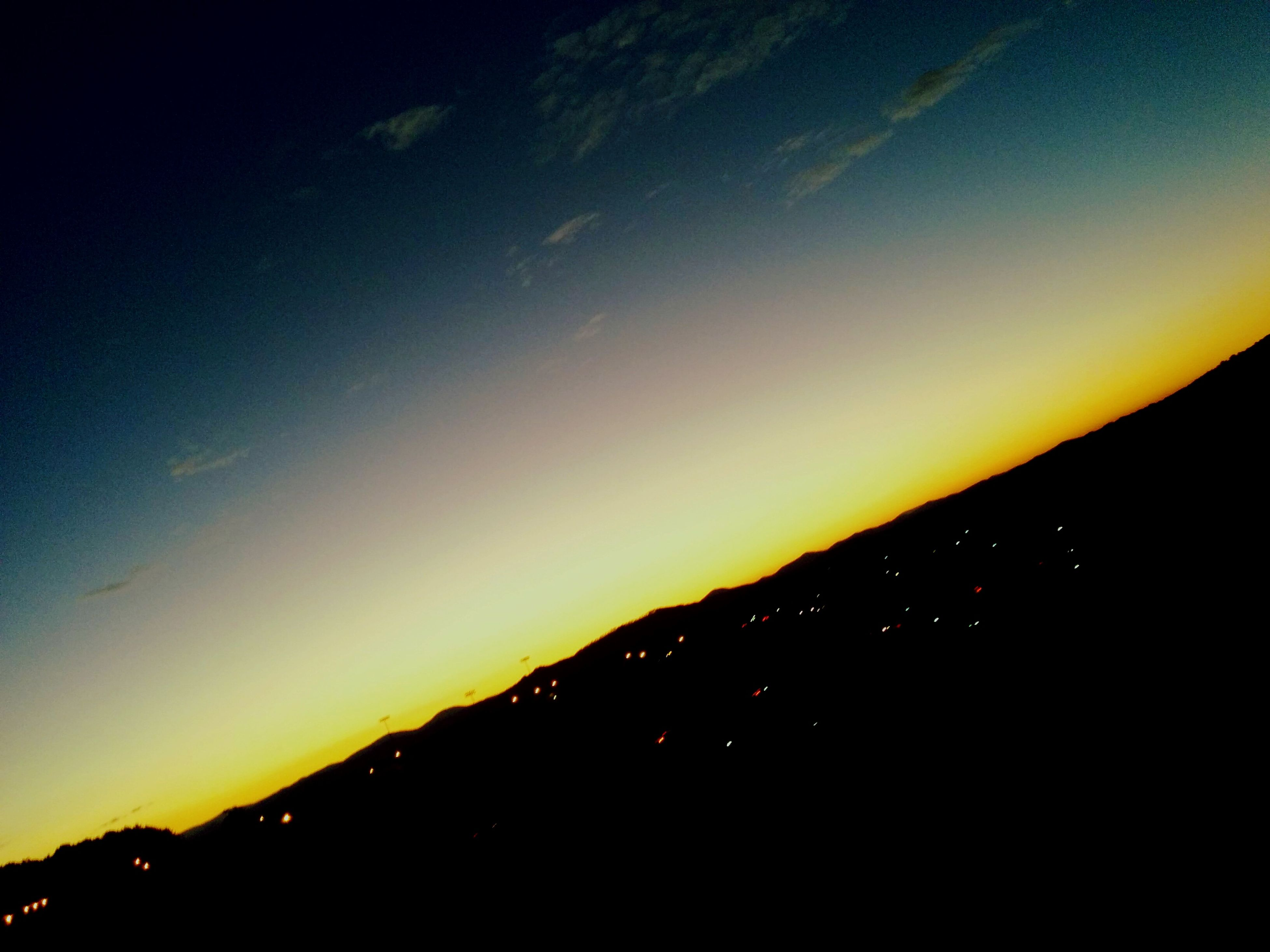 sunset, scenics, tranquil scene, silhouette, beauty in nature, tranquility, sky, orange color, idyllic, night, nature, dark, illuminated, copy space, landscape, dusk, yellow, outdoors, moon, no people