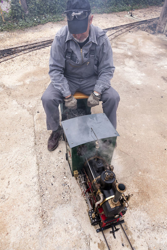 Train station 06 Coveralls Day Elevated View Low Angle View Miniature Miniature Museum Miniature Train Mode Of Transport Mode Of Transportation Museum Outdoors Pavement Paving Stone Person Rail Transport Rail Transportation Railroad Station Station Train Museum Train Station Train Tracks Trainstation Transportation