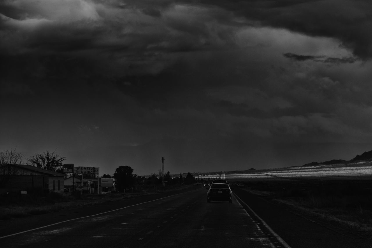 road, transportation, the way forward, cloud - sky, sky, outdoors, car, no people, storm cloud, day, built structure, nature, architecture
