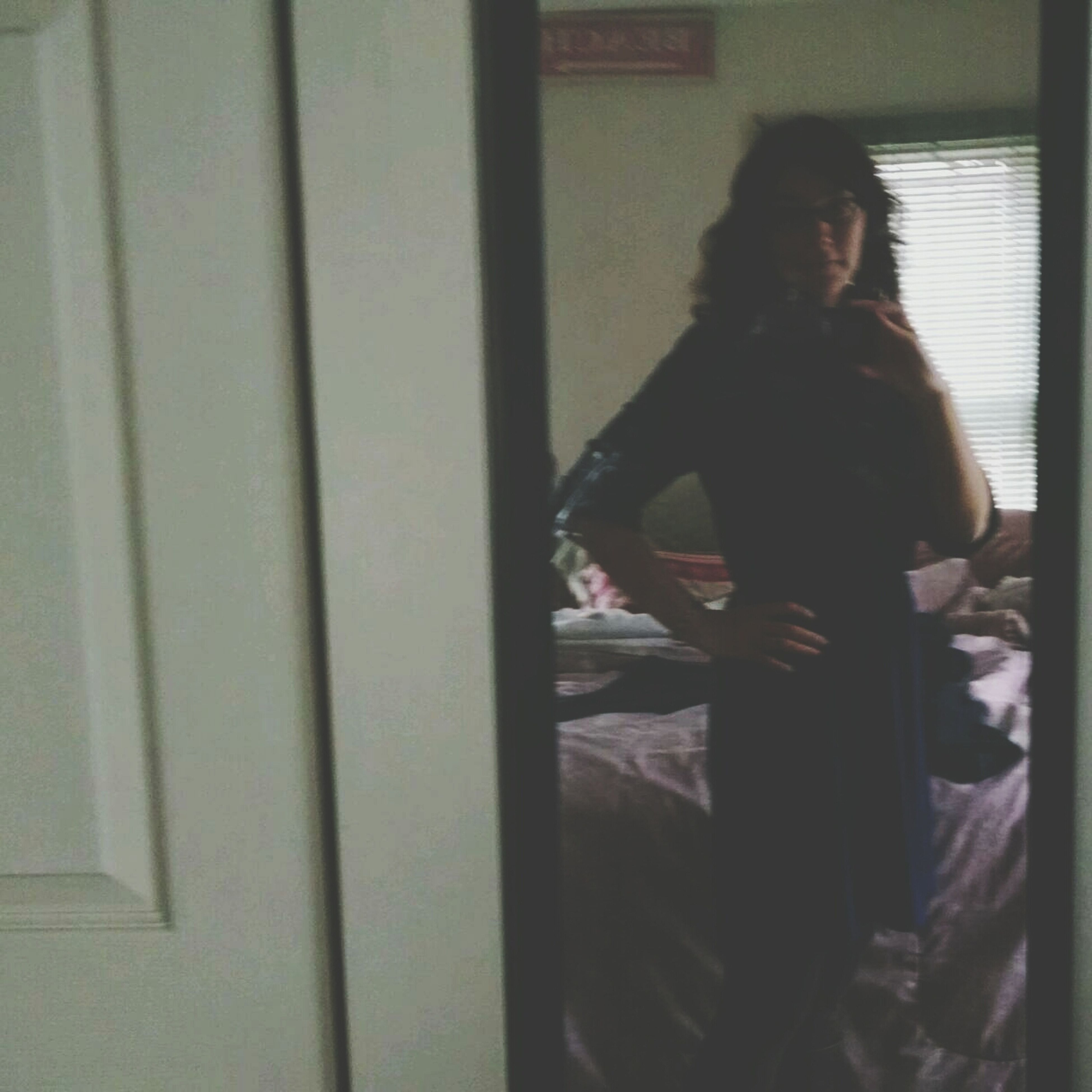 indoors, young adult, lifestyles, young women, standing, casual clothing, person, leisure activity, three quarter length, long hair, waist up, front view, wall - building feature, home interior, side view, contemplation, window