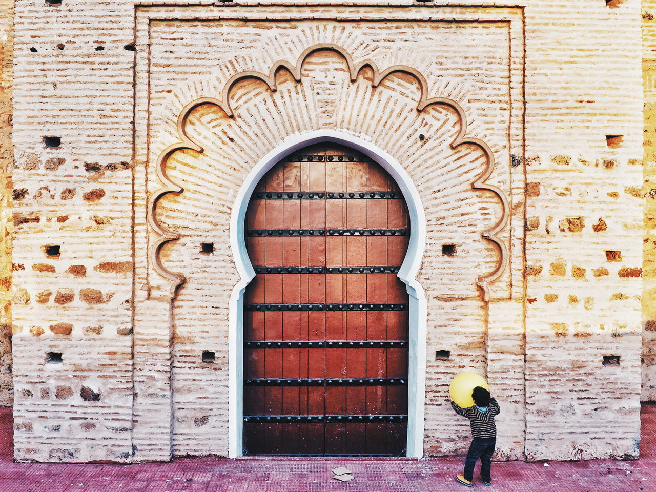 Door Entrance Day Architecture Doorway Built Structure Building Exterior Outdoors Real People People Adult One Person Adults Only Only Men Playing Playing Child Childhood Children Playing Mosque Islamic Architecture Marrakech Innocence Morocco Morocco 🇲🇦 The Secret Spaces