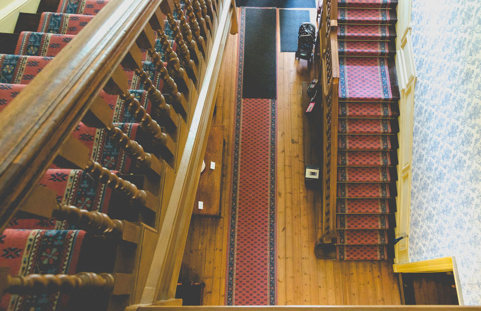 Staircase in old manor house view from top Architecture Balustrade Floor Geometric Shapes Hall Height Home Levels Manor House Open Space Parallel Residency Rug Staircase Stairs Straight Top View Top Views Vintage Wooden
