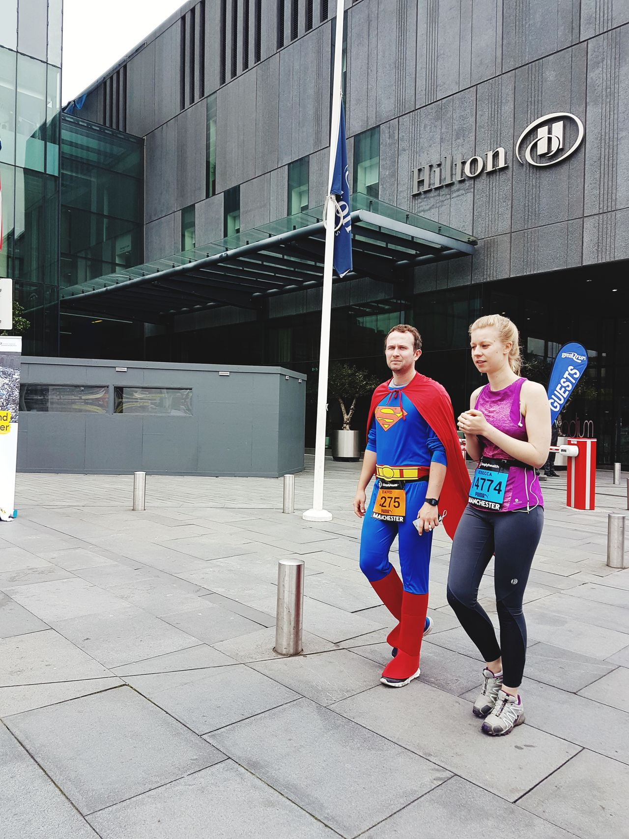 There I was, just minding my own business, when superman came along. Everyday Hero Two People Togetherness Outdoors People Full Length City Life Street Photography Carnival Crowds And Details Great North Run Charity Event Capturing The Moment Race Charity Adults Only Take It In Your Stride