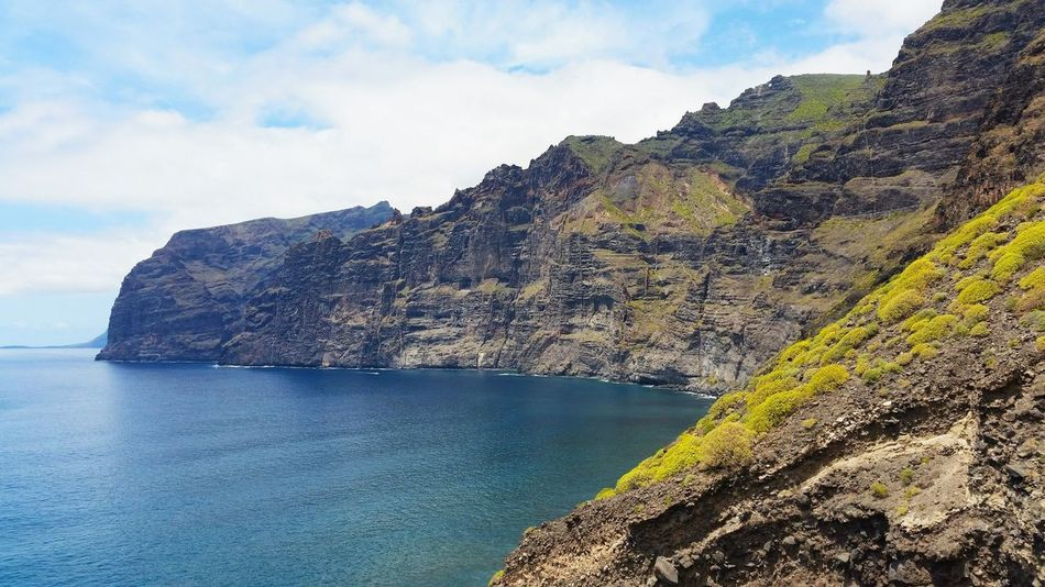 Sea Rock - Object Landscape Cliff Scenics Water Nature Coastline Beauty In Nature Outdoors Horizon Over Water Beach Limestone Sky No People Day Tenerife Los Gigantes