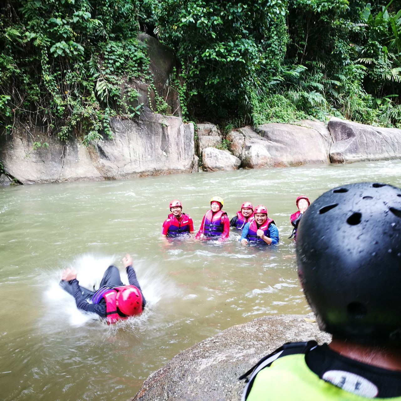 real people, water, leisure activity, adventure, lifestyles, river, men, rafting, day, medium group of people, togetherness, nature, vacations, outdoors, tree, women, sport, inflatable raft, beauty in nature, adult, people