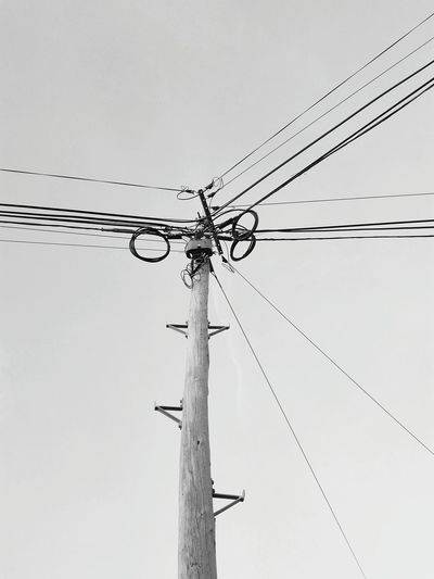 The electric wires Electricity Pylon Power Supply No People Day Sky Copy Space Backgrounds Negative Space Electric Wire Wooden Post Wires And Sky Wires And Cables Wires Up The Sky Electricity  Power Line  Connection Monochrome Photography Monochrome Black And White Photography Power Line  Technology Electricity  Cable Modern