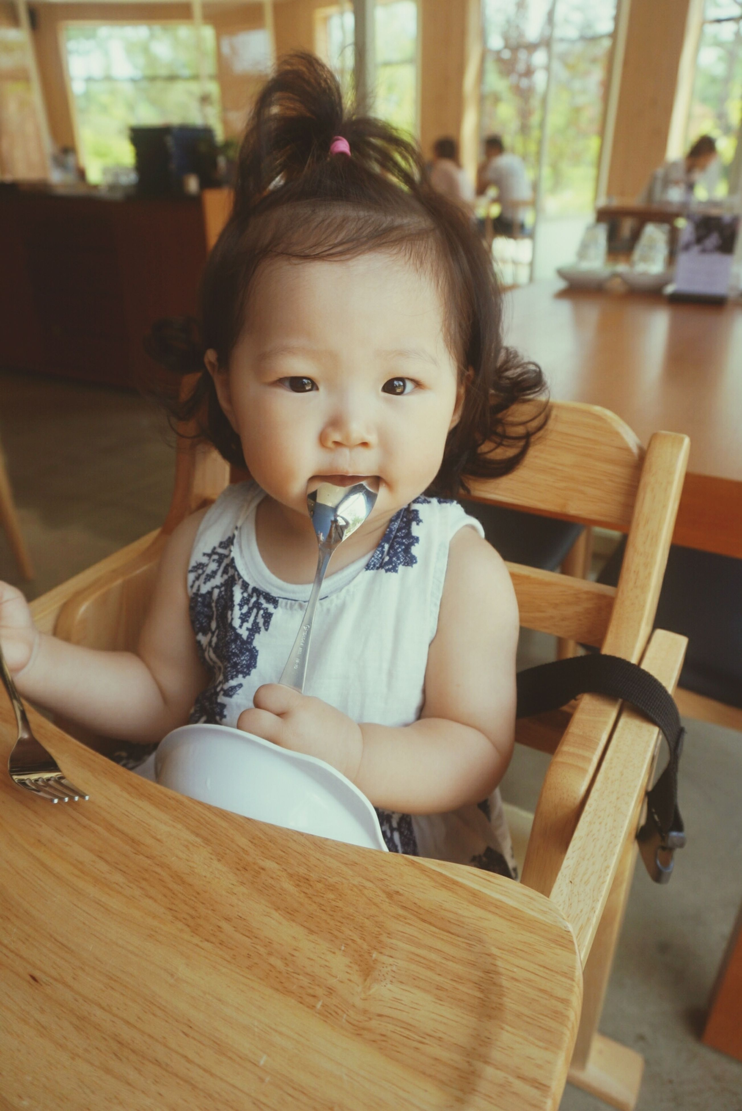 indoors, childhood, person, home interior, sitting, table, elementary age, cute, looking at camera, innocence, lifestyles, front view, portrait, casual clothing, leisure activity, chair, girls, boys