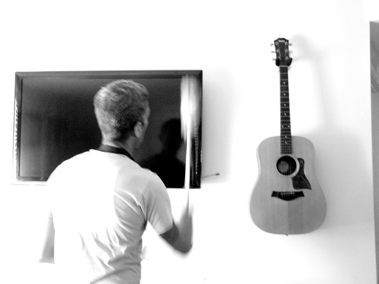 ~ Simplifying Life ~ Connection Person Technology Young Adult Monochrome Photography Blackandwhite White Wall Cleaning Dusting Indoors  Guitar Television Home Sweet Home Home Interior Simplicity Minimalism Man Brisk Life In Motion Home Decor Blurred Motion Motion Blur Busy Darkness And Light Household Chores