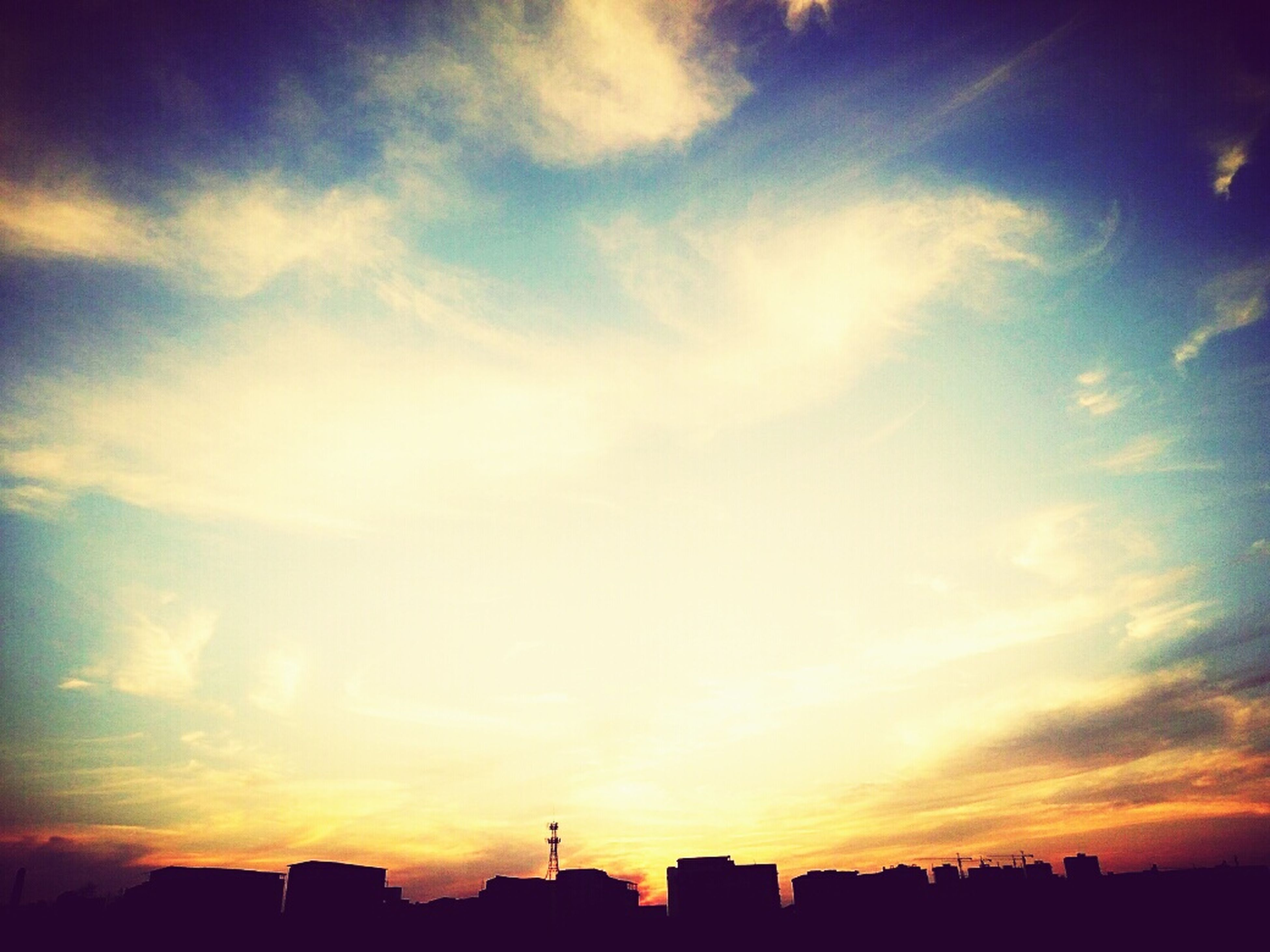sunset, silhouette, building exterior, sky, architecture, built structure, orange color, cloud - sky, city, scenics, beauty in nature, sun, sunlight, cloud, nature, tranquility, tranquil scene, outdoors, cityscape, low angle view