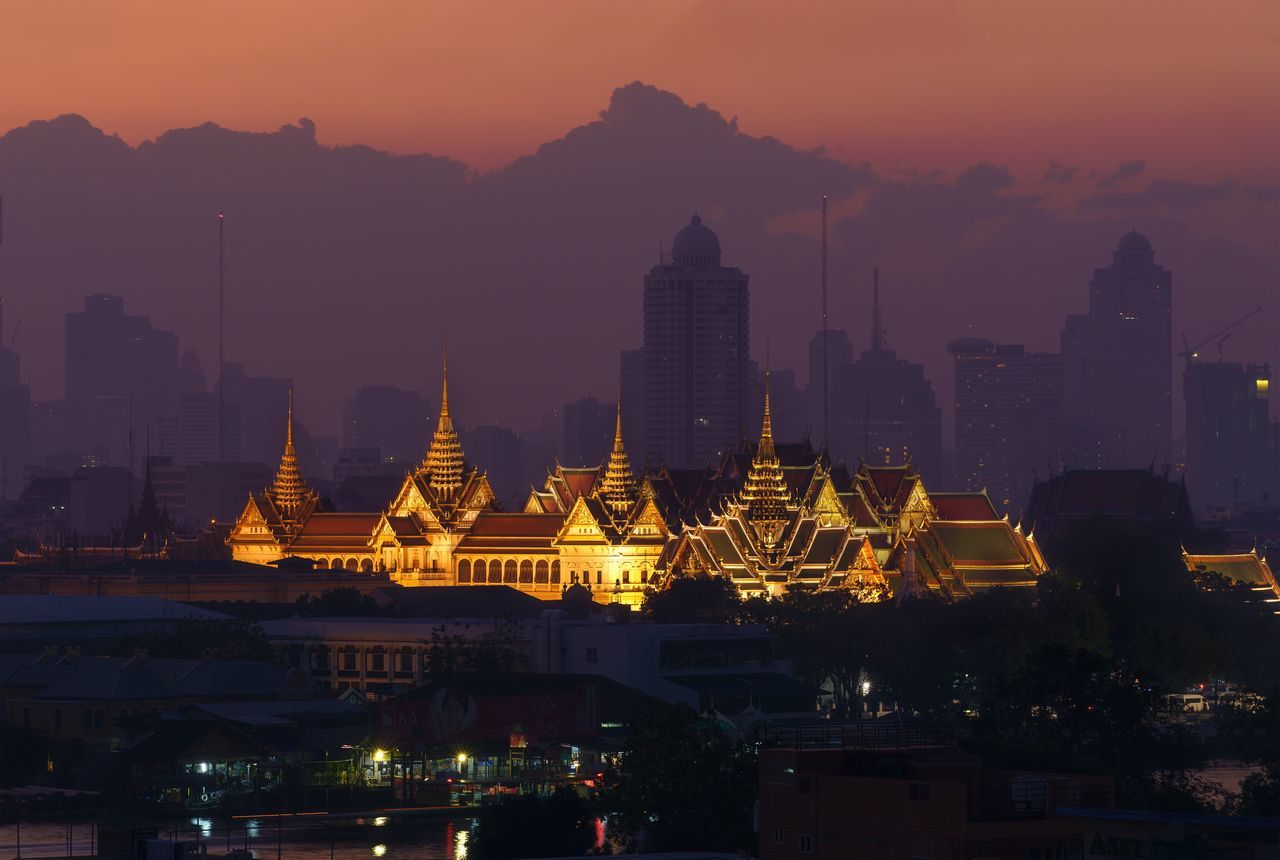 The Grand Palace of Thailand at Dawn against beautiful cloud and sky. Orange Sky Morning Light Grand Palace Bangkok Thailand Grand Palace Sunrise Tourist Destination Tourist Attraction  Clouds And Sky No People Outdoor Photography Building Exterior Culture Of Thailand Thai Architecture