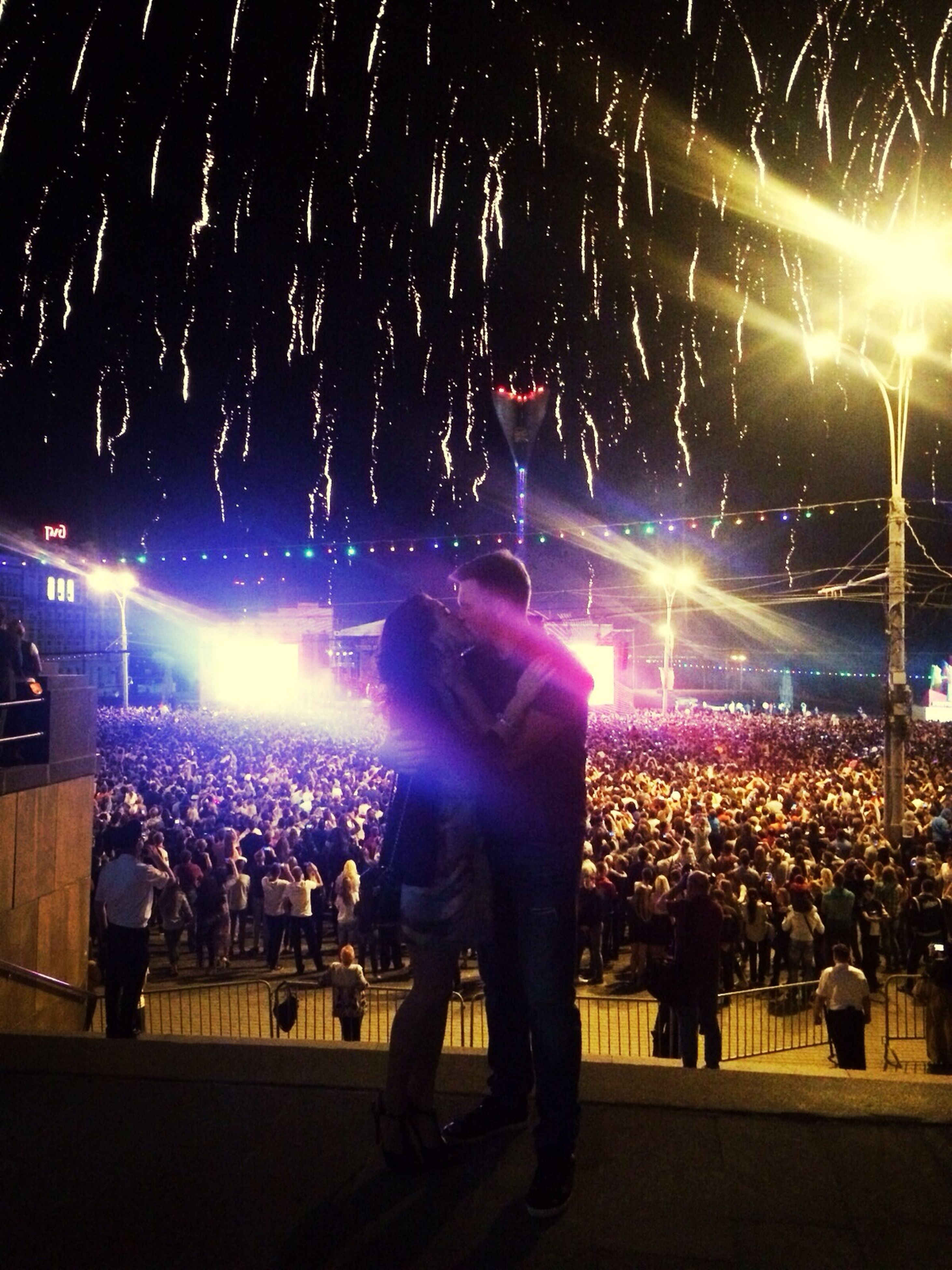 night, illuminated, celebration, arts culture and entertainment, event, large group of people, lifestyles, lighting equipment, leisure activity, men, firework display, crowd, exploding, enjoyment, person, glowing, firework - man made object, performance, nightlife