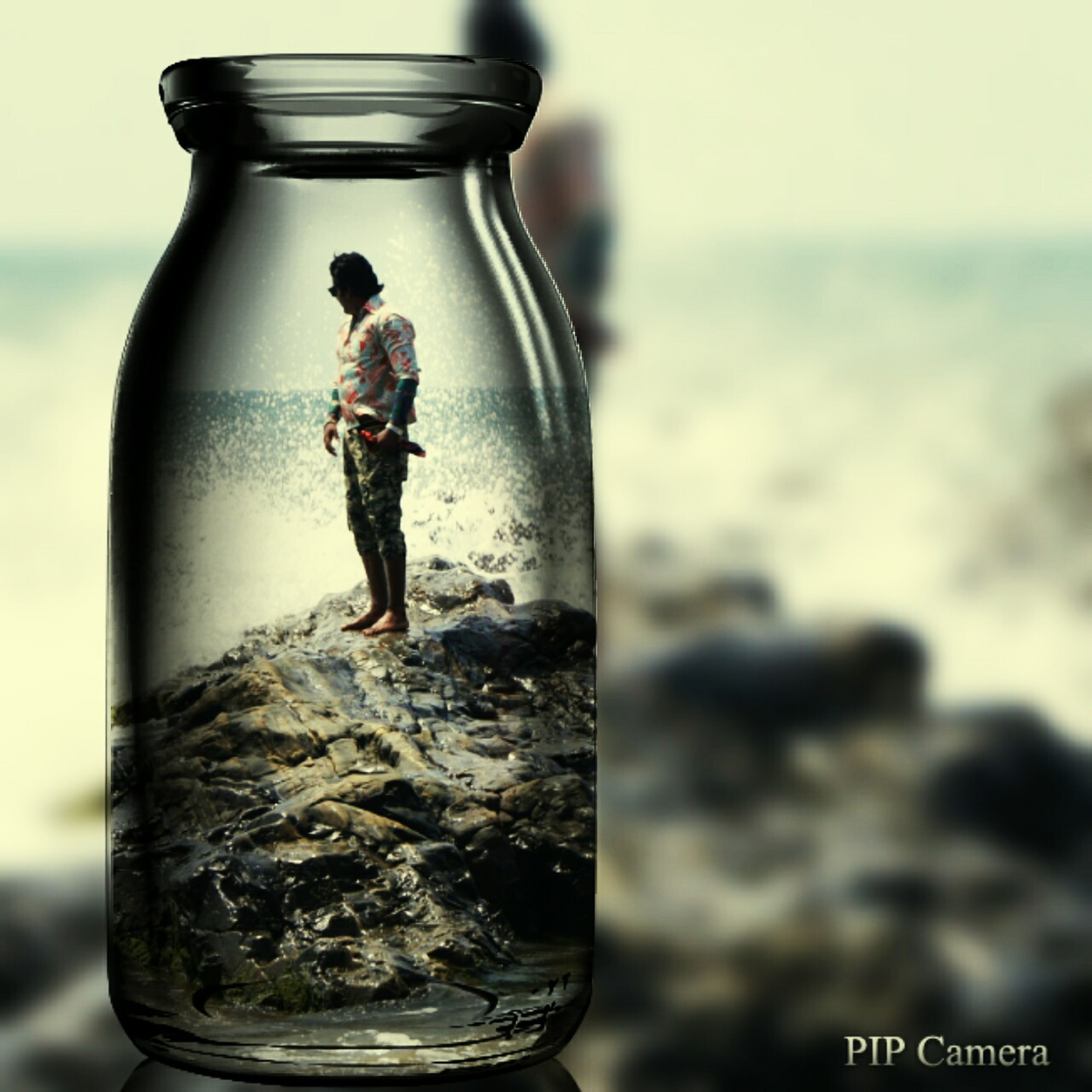water, focus on foreground, sea, close-up, beach, selective focus, lifestyles, splashing, leisure activity, refreshment, shore, drink, day, holding, horizon over water, transparent, reflection, outdoors