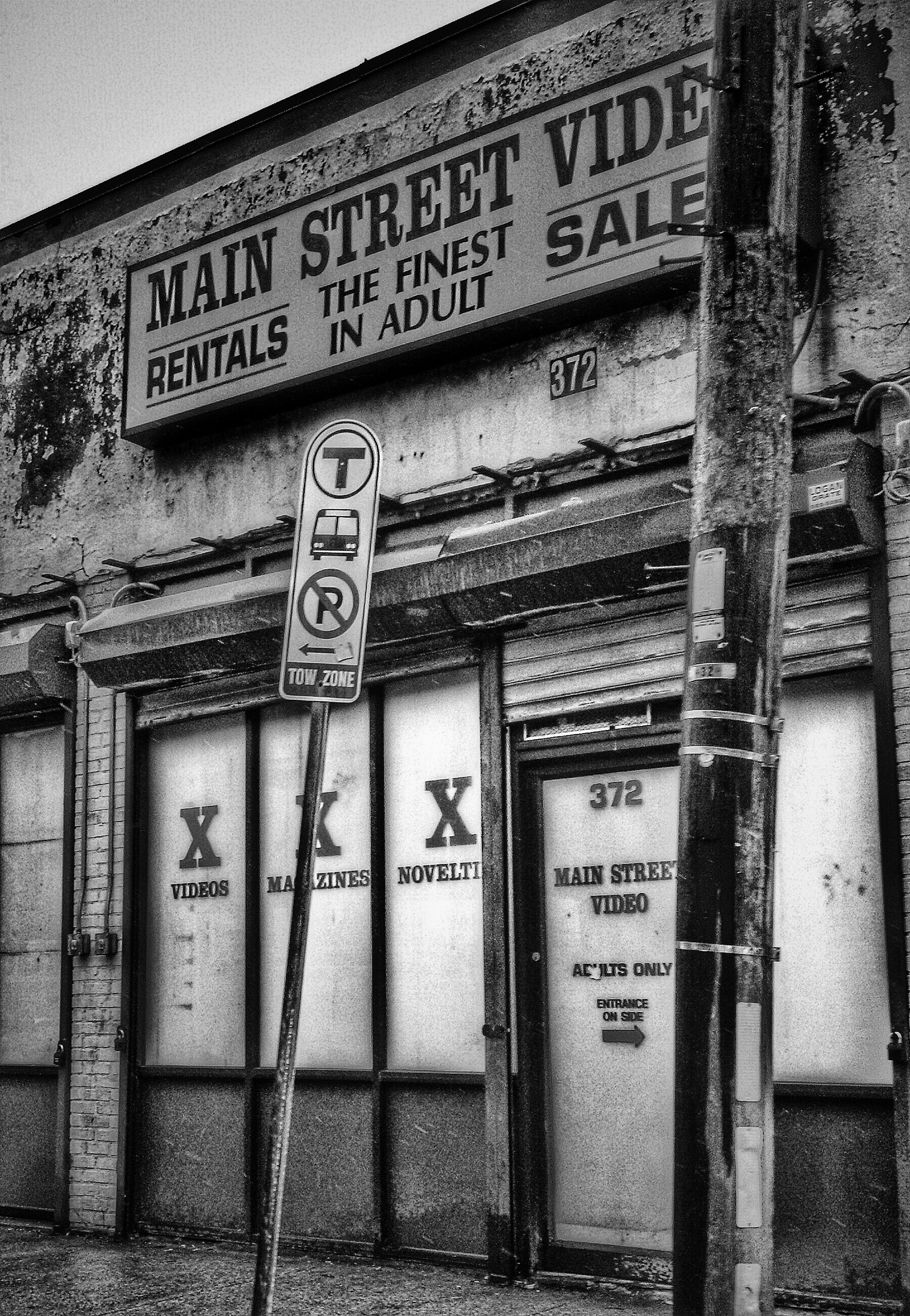 text, western script, communication, architecture, built structure, building exterior, non-western script, information, information sign, capital letter, wall - building feature, sign, number, old, outdoors, no people, day, low angle view, door, wall