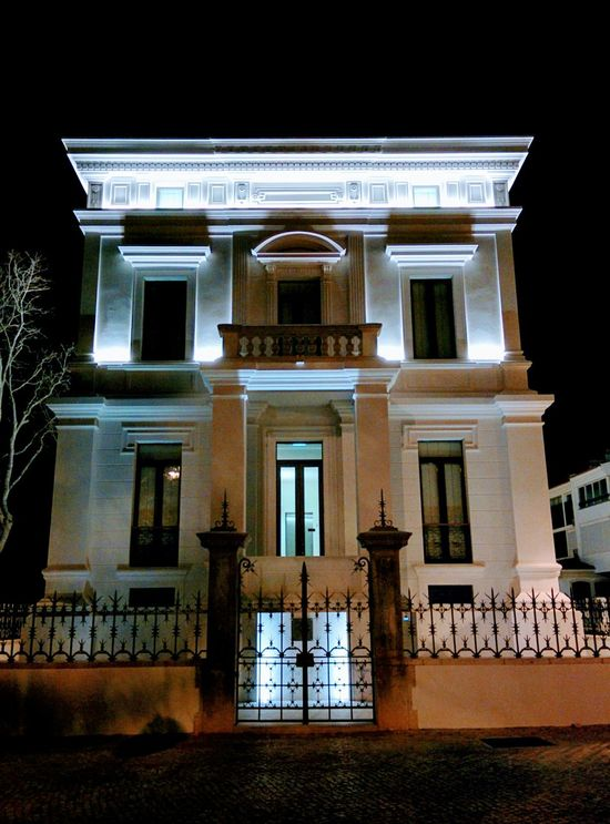 Architecture Building Exterior Built Structure Night No People Outdoors Sky City Building Feature Urbanphotography Urban Exploration Urban Architecture Rehabilitated Rebuild To Renew White Color Architecturephotography Illuminated Façade Architectural Column Low Angle View Urbanexploration