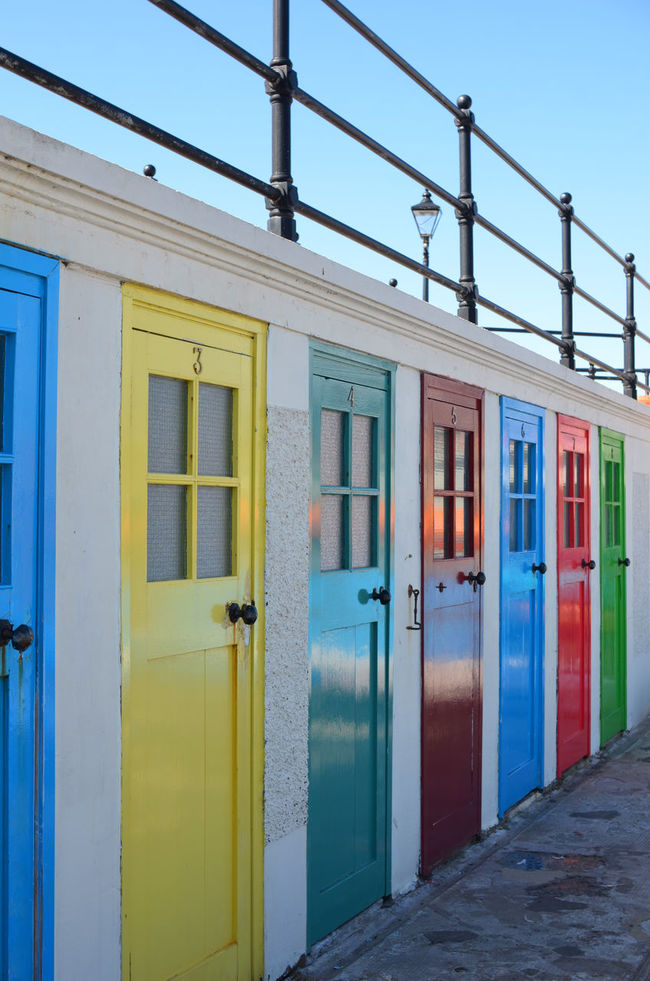 Architecture Beach Beach Hut Beach Huts Blue Building Exterior Built Structure Door Doors Fence In A Row Multi Colored Summer Summertime Vibrant Color Window