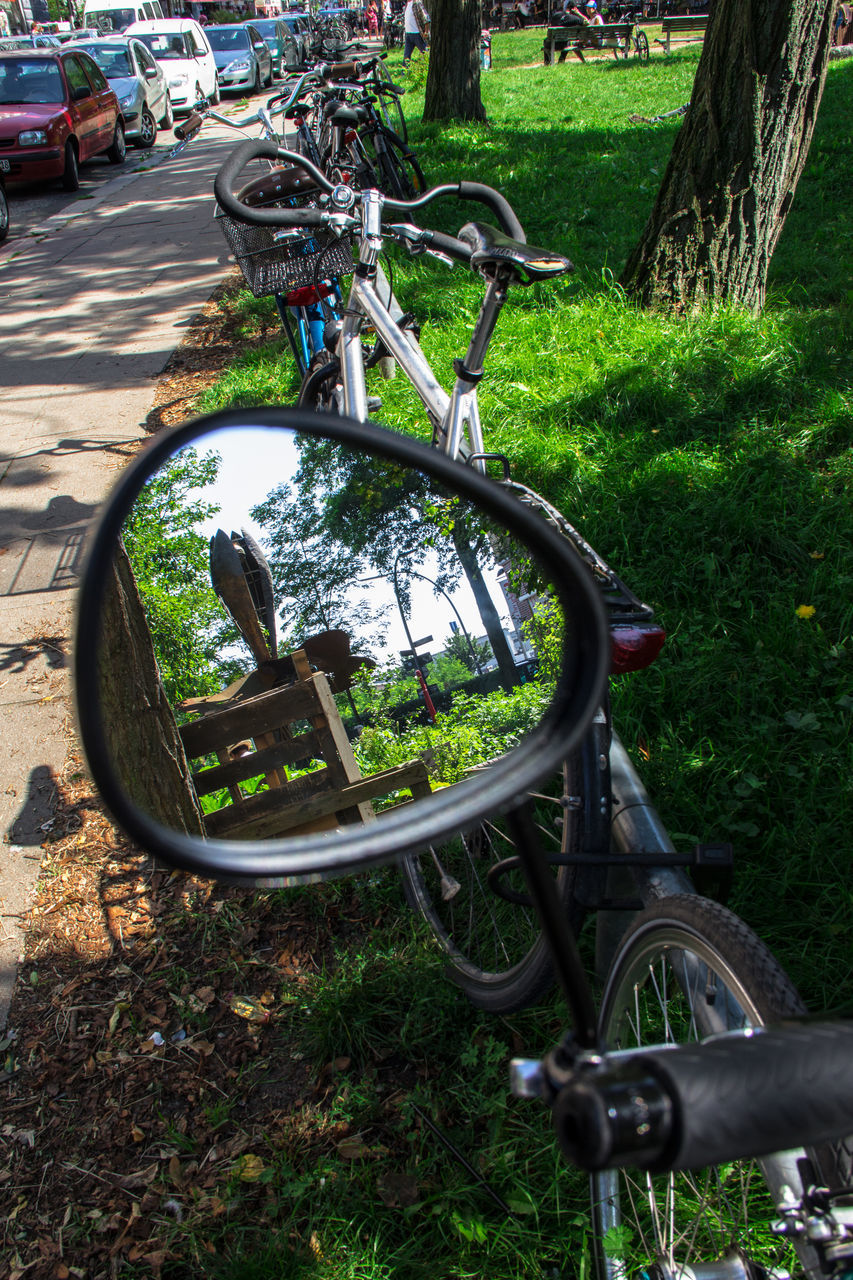 transportation, land vehicle, bicycle, mode of transport, stationary, grass, day, wheel, outdoors, no people, car, bicycle rack, tree, spoke, growth, nature, tire