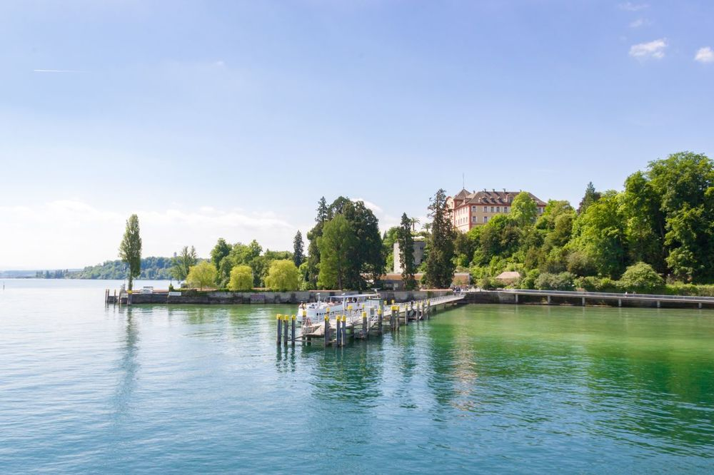 Insel Mainau Architecture Built Structure Water River Tree Building Exterior Bridge - Man Made Structure Waterfront Sky Day Outdoors Nature No People Beauty In Nature Insel Mainau Bodensee Ladyphotographerofthemonth Bavarian Landscape Bavaria Lake Pier Lush Foliage Lush Greenery