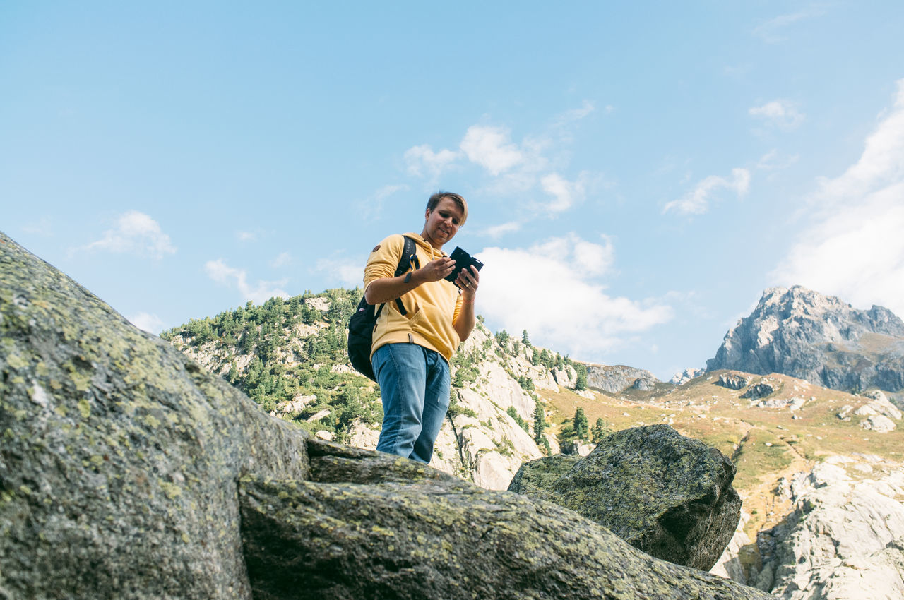 Beautiful stock photos of phone, At The Edge Of, Backpack, Boulder, Day