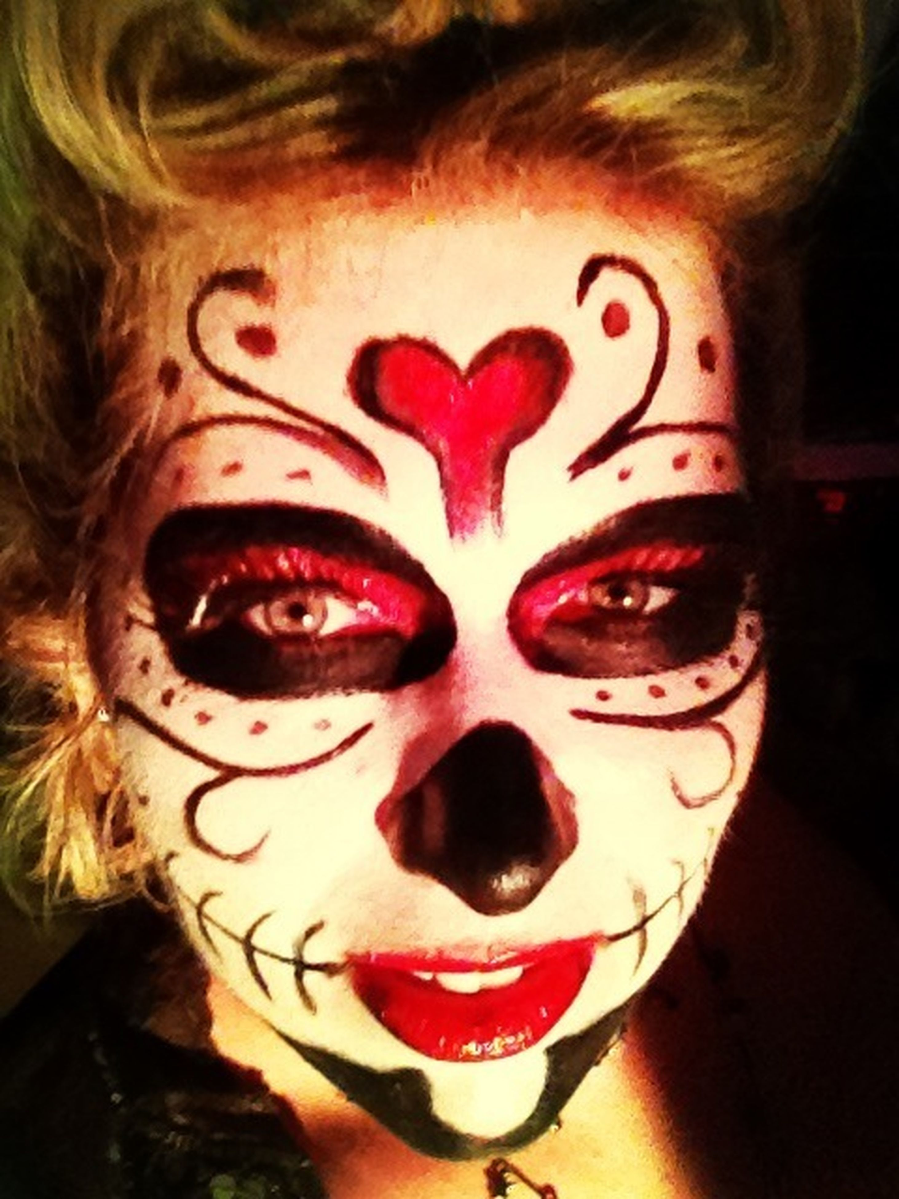 indoors, creativity, art, human representation, art and craft, close-up, celebration, portrait, anthropomorphic face, halloween, mask - disguise, looking at camera, heart shape, red, one person, still life, front view, tradition