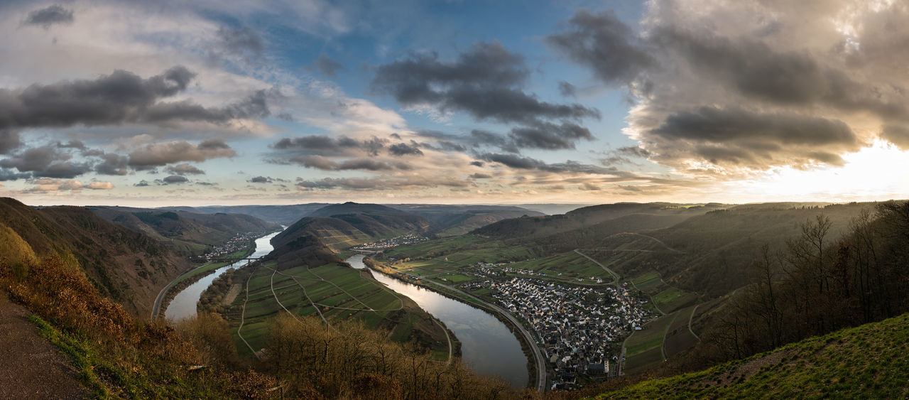 Panoramic view over the Moselle loop near Bremm at sunset with beautiful golden light and clouds Beauty In Nature Bremm Calmont Cloud Cloud - Sky Curve Dramatic Sky Germany High Angle View Landscape Loop Moselle Nature No People Outdoors Rhineland River Scenics Sunset Tourism Tranquility Vineyard Wine Wine Country