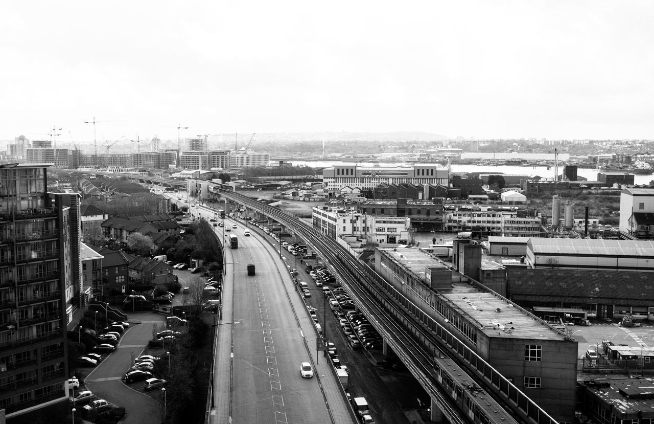 transportation, road, traffic, cityscape, city, car, high angle view, architecture, no people, sky, outdoors, building exterior, day