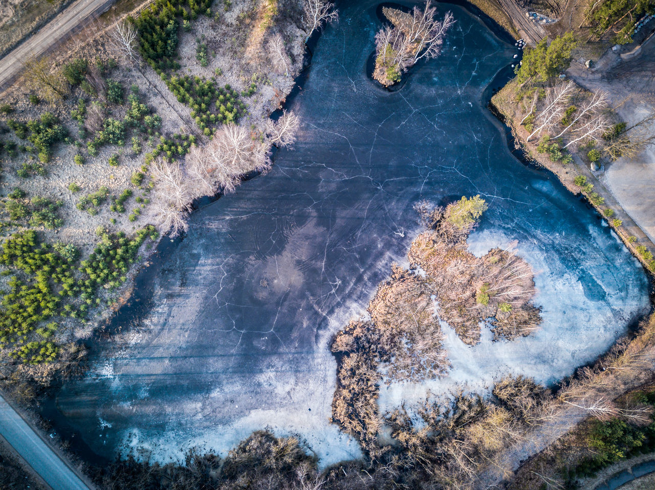Aerial shot of lake with cracked ice cover - spring is coming, nature wakes up / Dji Mavic Pro drone Aerial View Beauty In Nature Cracked Cracked Ground Crazed Dji DJI Mavic Pro Djimavic Drone  Dronephotography High Angle View Ice Ice Covered  Lake Landscape Mavic Melting Nature Snow Split Spring Springtime Trees Wallpaper Water Flying High Flying High Flying High
