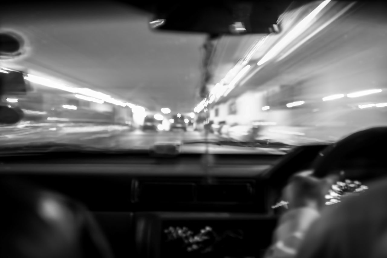 mode of transport, transportation, car, land vehicle, real people, public transportation, train - vehicle, illuminated, one person, night, indoors, vehicle seat, close-up, people