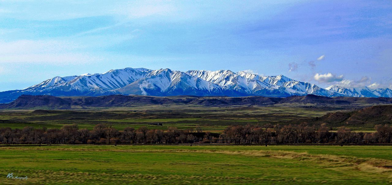 Rocky Mountain Landscape Mountain Landscape Sky Scenics Beauty In Nature Nature Tranquil Scene Field Grass Blue Mountain Range No People Cloud - Sky Outdoors Day Snow The Great Outdoors - 2017 EyeEm Awards