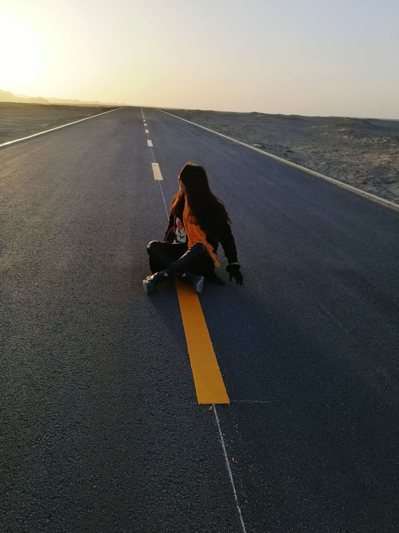 Travel One Person Adventure Sunset Lonley Road Nature Sky Sitting On My Way To... Peaceful Evening ePeace And Quiet Lonely Trip Evening Time The Road To Uncertainty The Way Forward The Road Goes On Forever The Road So Far People Photography People Miles Away