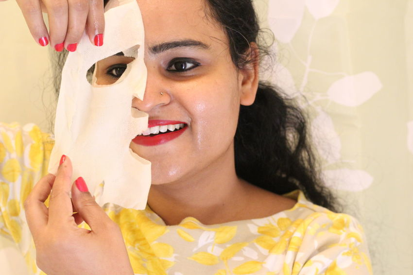 face sheet mask, beauty care, skin care, skin treatment, relaxation, relaxing at spa , skincare woman Beautiful Woman Beauty Cheerful Close-up Happiness Headshot Holding Human Body Part Human Hand Indoors  Lifestyles Looking At Camera Moisturizer One Person One Woman Only One Young Woman Only Only Women Portrait Real People Skin Care Smiling Toothy Smile Women Young Adult Young Women