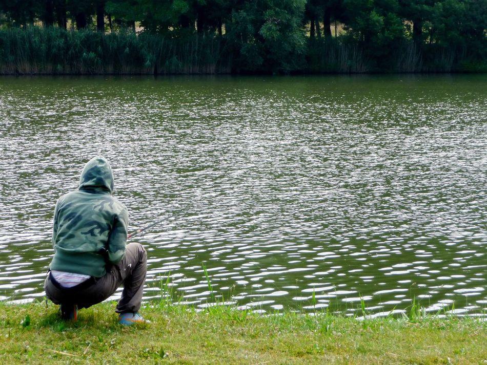 Fishing Man Fishing Green Colour Palette Lake Italy Eyeemphoto EyeEm Best Shots EyeEm Nature Lover EyeEm Gallery People And Places Long Goodbye