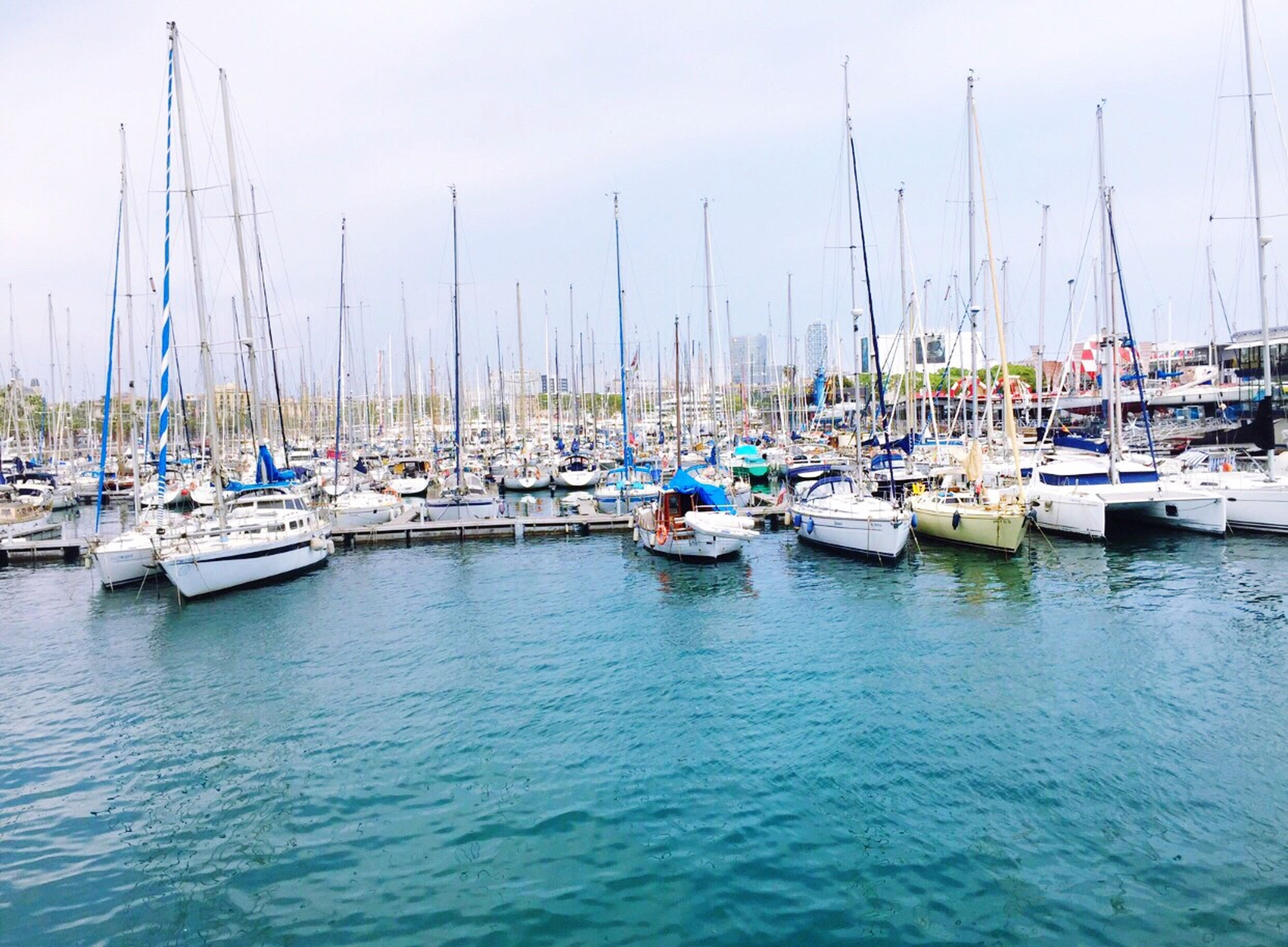 nautical vessel, transportation, moored, boat, mode of transport, water, mast, harbor, sailboat, sea, waterfront, sky, marina, travel, yacht, in a row, outdoors, reflection, day, blue