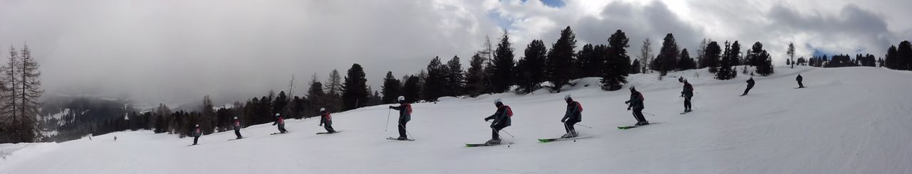 winter, snow, cold temperature, weather, nature, panoramic, white color, tree, tranquility, skiing, scenics, beauty in nature, day, sport, sky, cloud - sky, outdoors, leisure activity, tranquil scene, winter sport, landscape, ski holiday, real people, adventure, lifestyles, vacations, full length