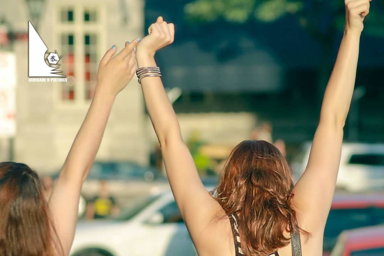 arms raised, focus on foreground, rear view, human body part, human arm, real people, leisure activity, long hair, outdoors, fun, women, day, headshot, one person, young adult, water, young women, human hand, people, close-up, adult, adults only
