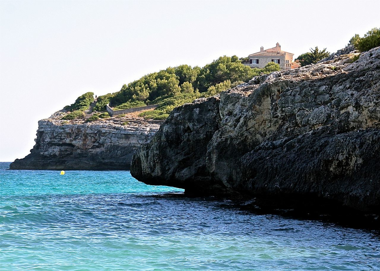 Architecture Beach Beauty In Nature Beauty In Nature Blue Cliff Coastline Green Hidden Gems  Holiday Mallorca Mediterranean Sea Nature Rippled Rock Rock Formation Rocky Scenics Sea Seaside Sky SPAIN Tranquil Scene Travel Wineandmore