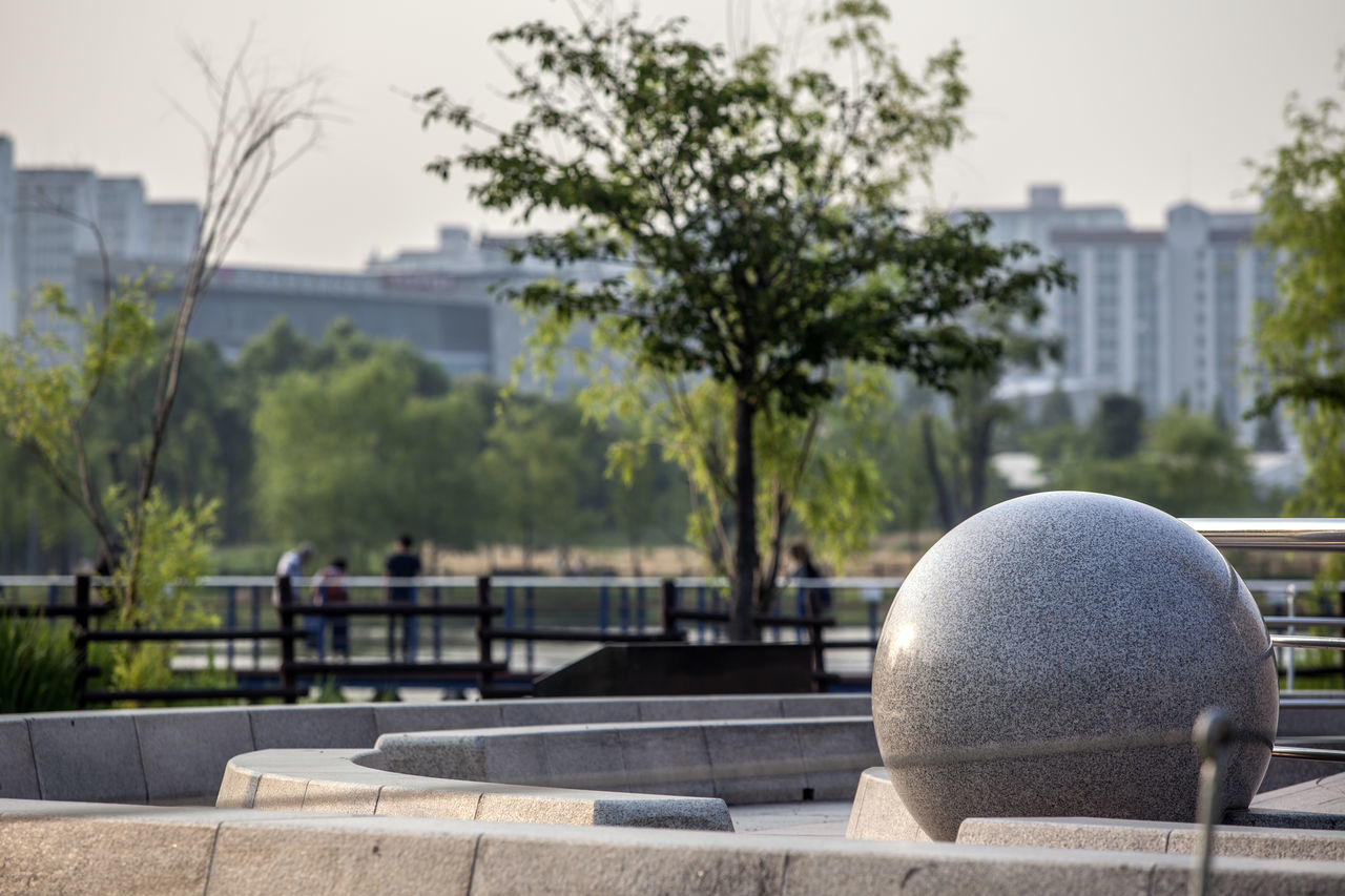 Architecure Ball Bucheon Lake Park City City Life Cityscape Close-up Day Focus On Foreground Growth Nature Outdoors Park River Round Sculpture Selective Focus Sky Stone Balls Tranquility Travel Destinations Tree