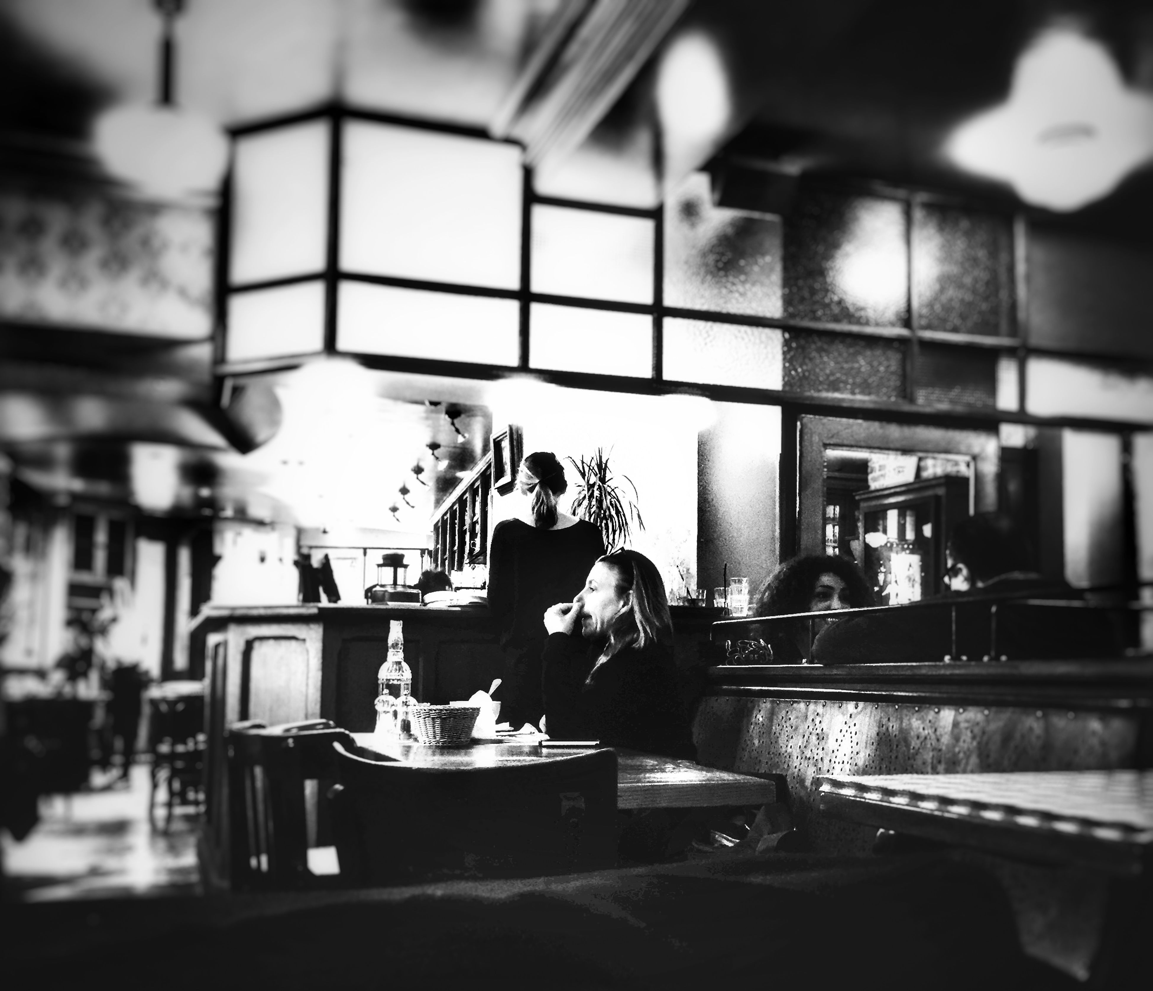 indoors, table, illuminated, food and drink, focus on foreground, restaurant, selective focus, domestic kitchen, still life, close-up, chair, incidental people, reflection, kitchen, stove, no people, preparation, container, kitchen utensil, absence